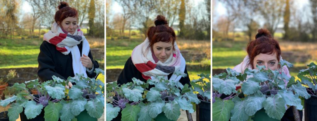 Simone wearing her handmade shawl outside in a garden in front of frozen kohlrabi