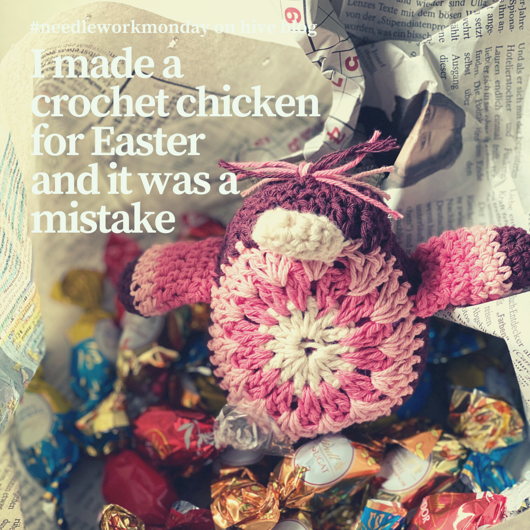 an open present with chocolate eggs and a crochet chicken decoration for Easter